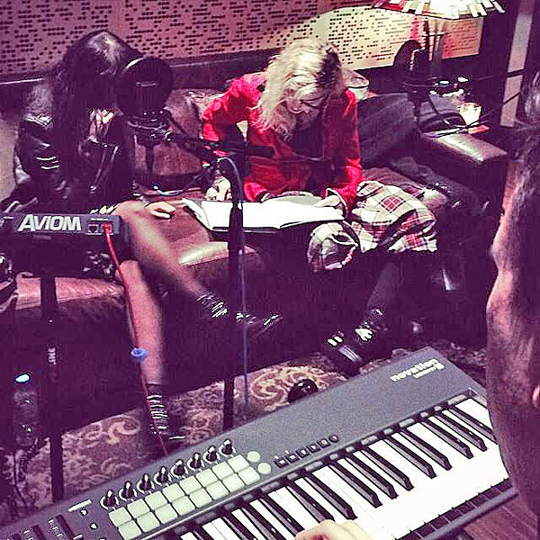 """Working the midnight shift with Natalia Kills. 2 girls on a couch..........don""t it taste like Holy Water? #artforfreedom #rebelheart #revolutionoflove"" -Madonna"